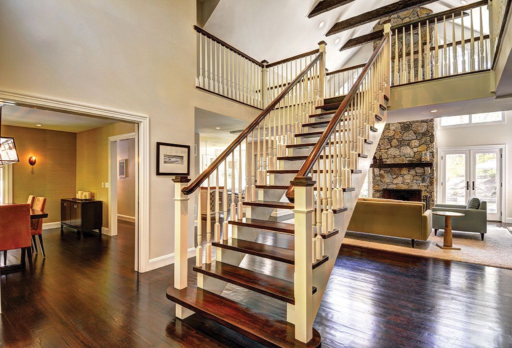 Traditional Staircase With Exposed Beam, Hardwood Floors, Balcony, Floating  Staircase