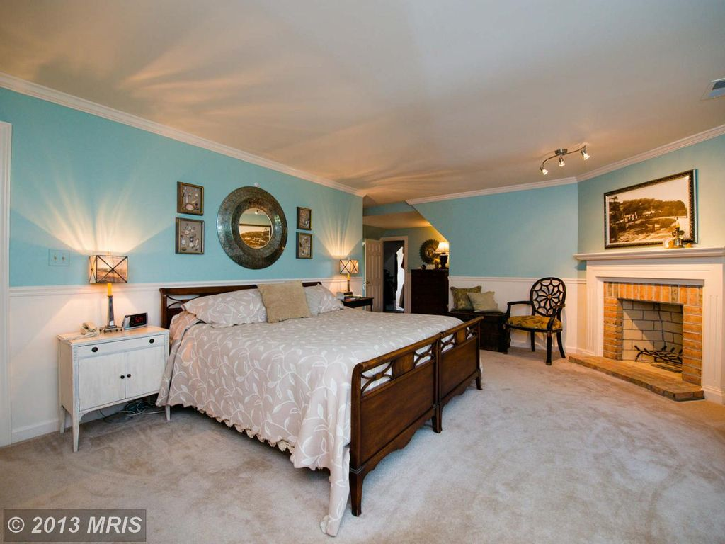 traditional master bedroom with chair rail & carpet in fallston