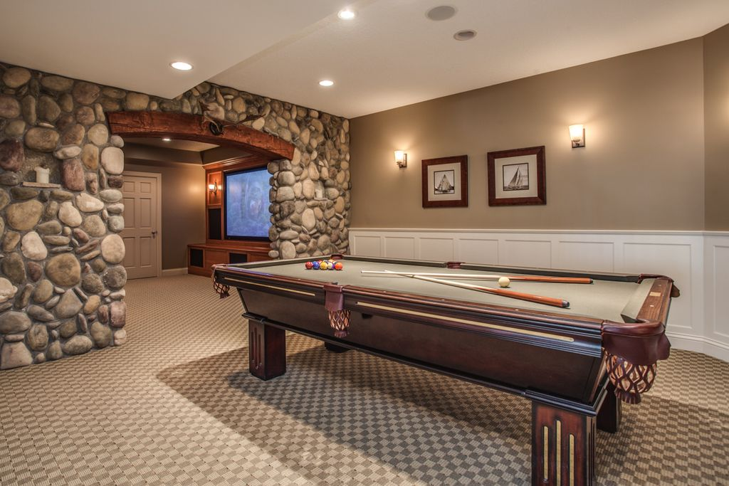 traditional game room with wainscoting carpet in