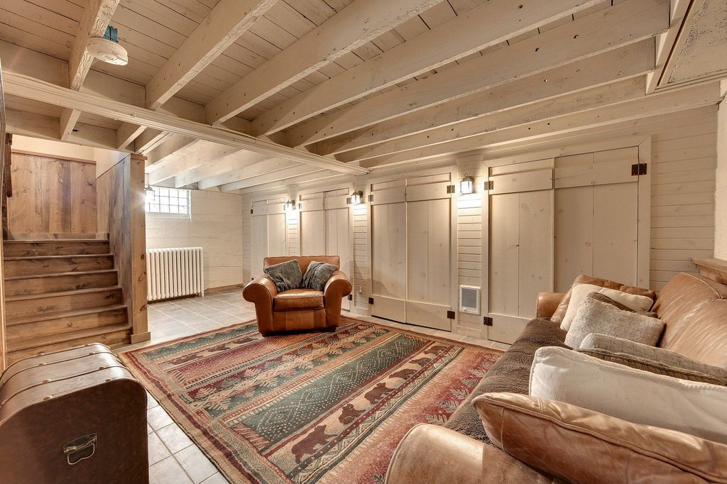 Rustic Basement With Wall Sconce Whitewashed Exposed Beam Ceiling In Mi