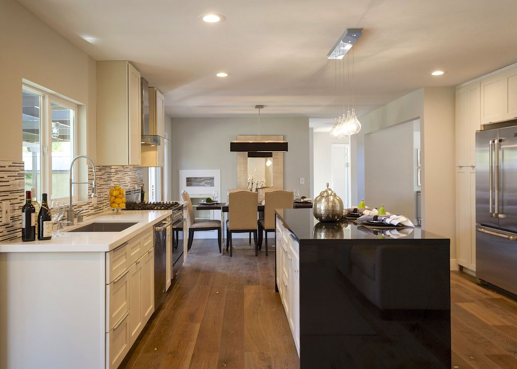 contemporary kitchen with waterfall countertop & flat panel