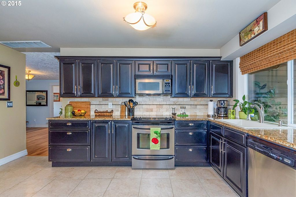 traditional kitchen with kendall raised panel cabinetry briton bone 12 in x 12 in - Raised Panel Home 2015