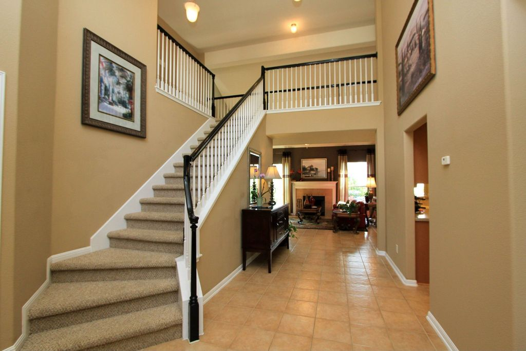 Traditional Staircase with High ceiling Carpeted steps in Cedar