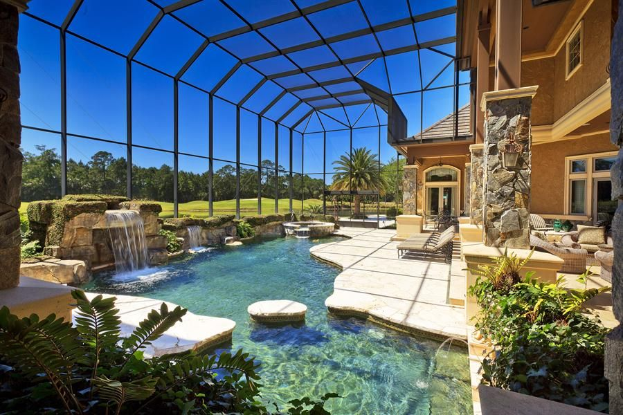 traditional swimming pool with fountain skylight exterior stone floors pool with hot tub - House Pools Design