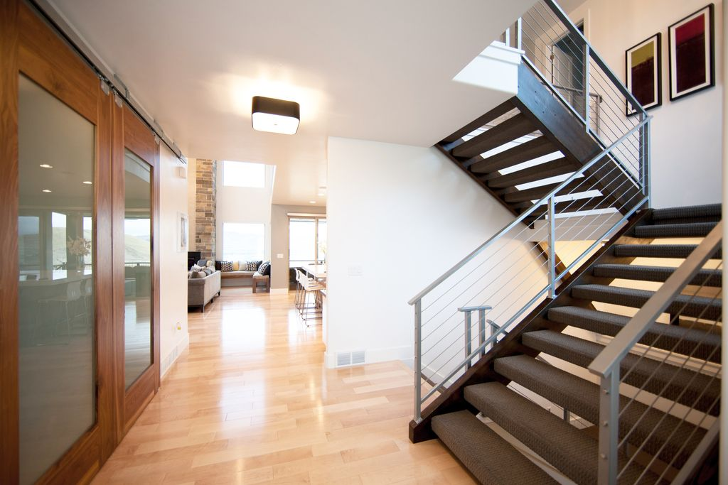 Contemporary Staircase with flush light, Hardwood floors, High ceiling
