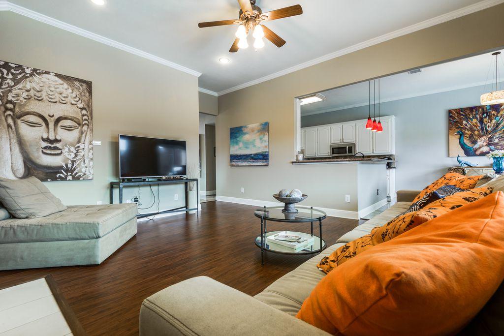 Asian Living Room With Crown Molding, Flush Light, Hardwood Floors, High  Ceiling,
