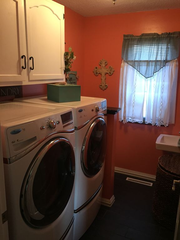 Traditional Laundry Room With Zinfandel Cabinet Doors, Kenmore Front Load  Steam Washer U0026 Dryer