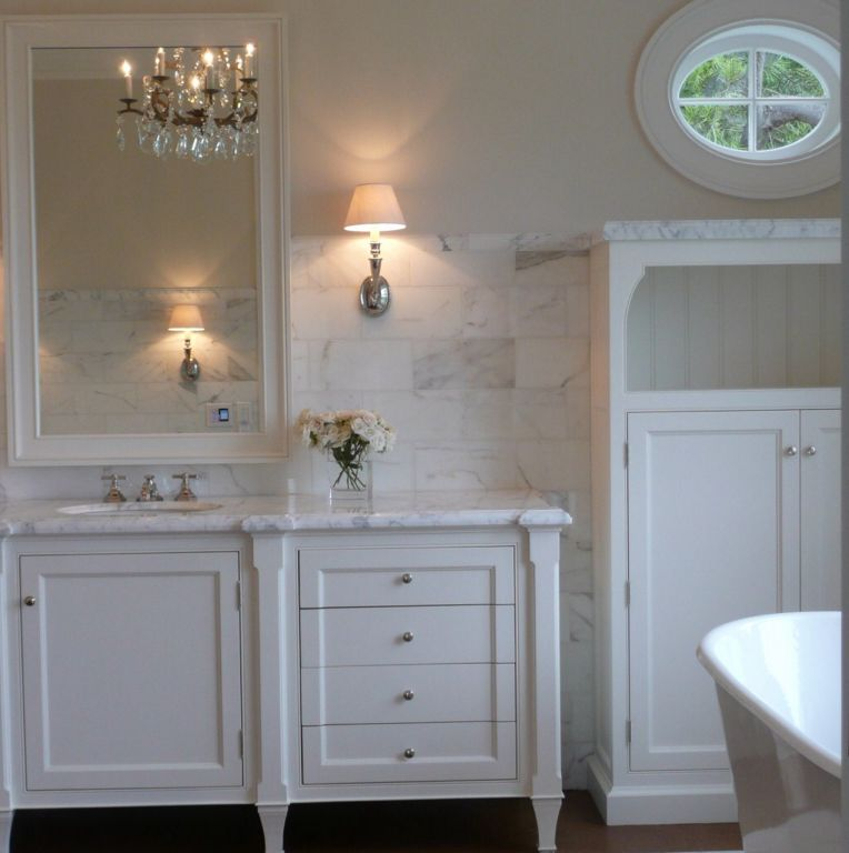 Bathroom Chandelier Sconces traditional full bathroom with flat panel cabinets & simple marble