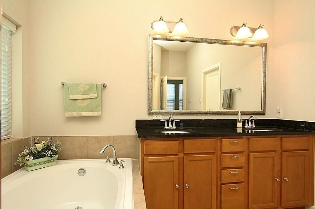 Bathroom Sinks Houston Texas traditional master bathroom with double sink & raised panel in