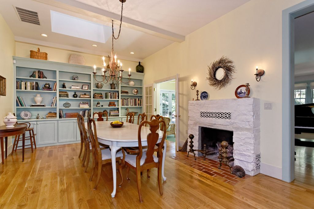 Country Dining Room With Skylight Stone Fireplace Chandelier Box Ceiling French Doors