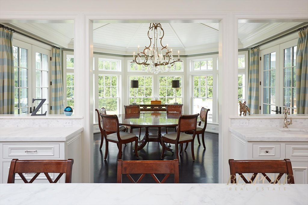 Traditional Dining Room With Concrete Floors Chandelier Cathedral Ceiling Exposed Beam
