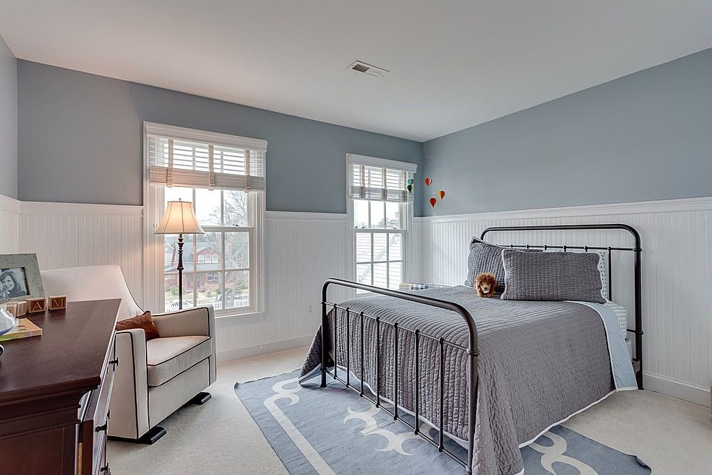 Cottage guest bedroom with carpet wainscoting zillow Images of wainscoting in bedrooms