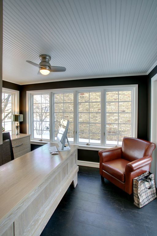 Cottage Home Office with Ceiling fan by Woodstone Renovation