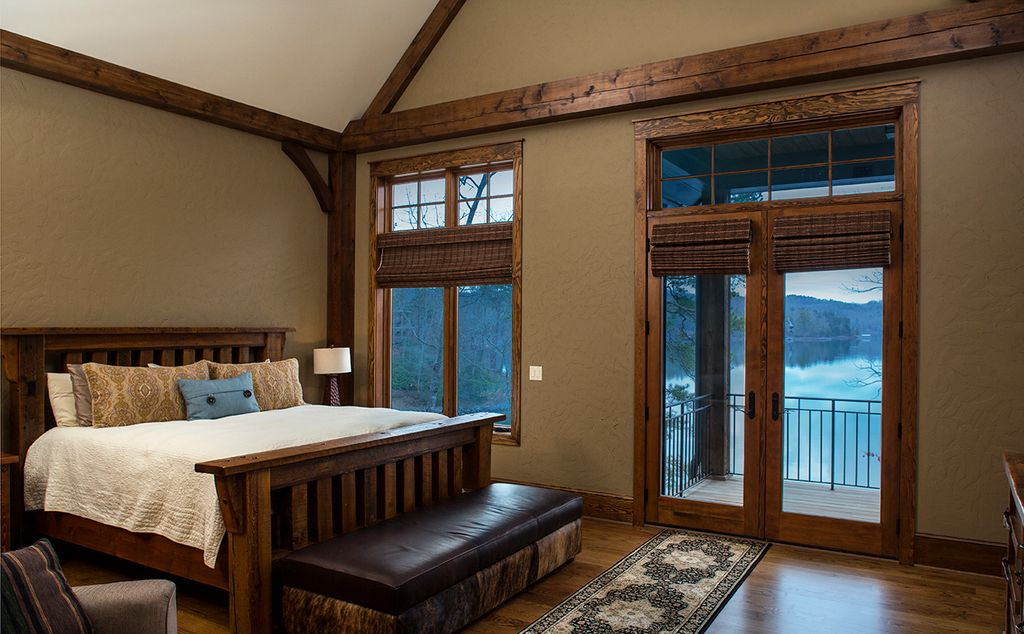 Rustic Master Bedroom With Zahir Brown Storage Bench Hardwood Floors Natural Woven Tailored Shades