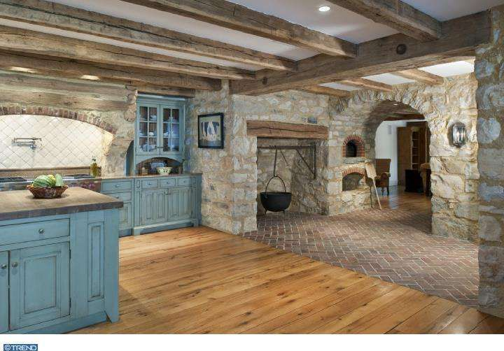 Cottage Design Ideas a lovely cottage retreat 2 Tags Cottage Room With Interior Rock Wall Arched Doorway Stained Cabinet Doors Exposed Beam