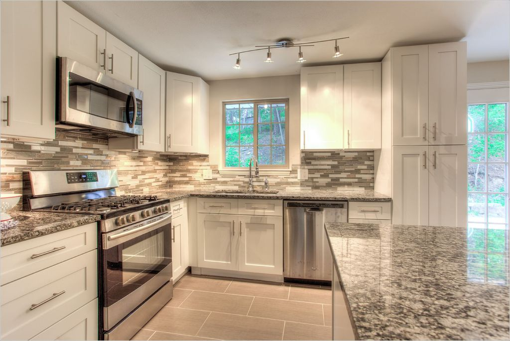 Kitchen Design Evergreen Co contemporary kitchen with flat panel cabinets & ceramic tile in