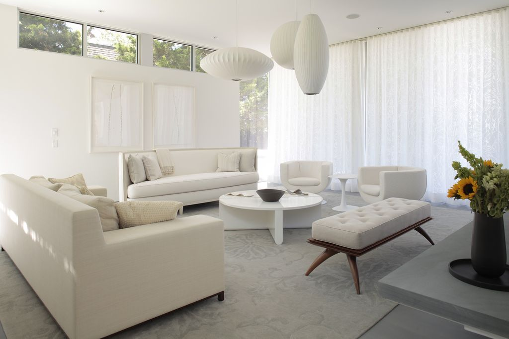 Contemporary Living Room With George Nelson Saucer Lamp Concrete Floors Pendant Light Saarinen