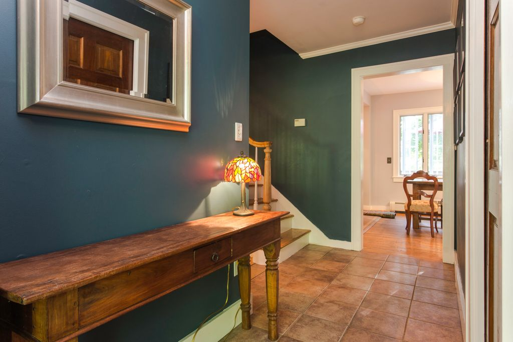 traditional hallway with crown molding