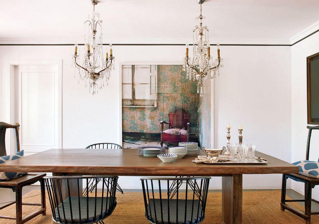 Eclectic Dining Room With Concrete Floors Crown Molding Specialty Door Chandelier