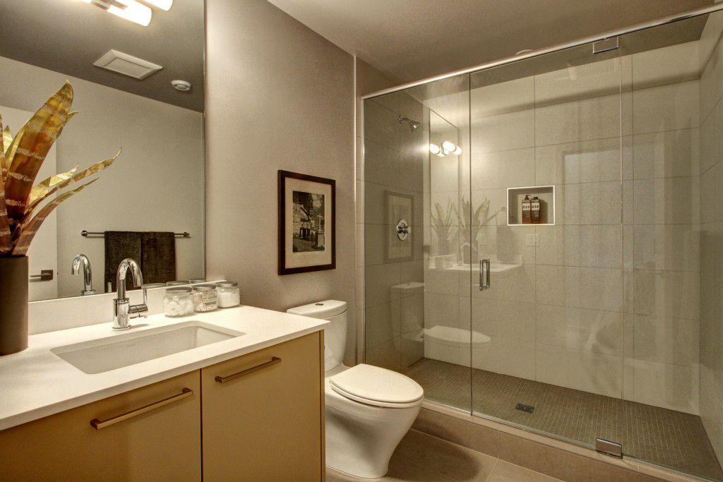 modern 34 bathroom with wall sconce travertine tile floors pental quartz