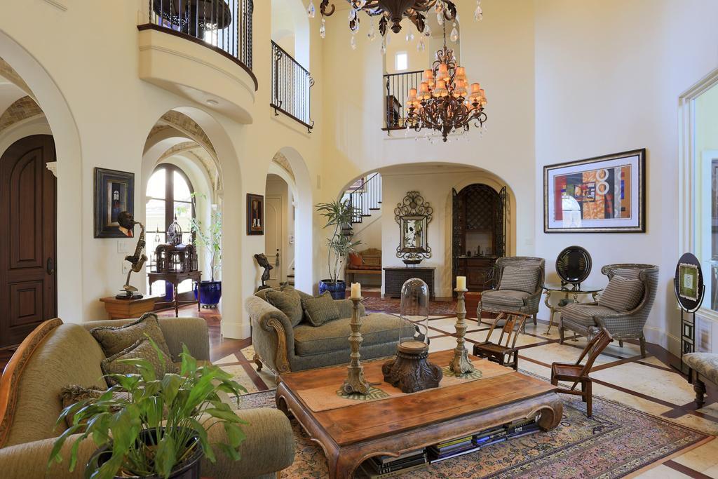 Mediterranean Living Room With Carpet, High Ceiling, Chandelier, Limestone  Tile Floors, Balcony
