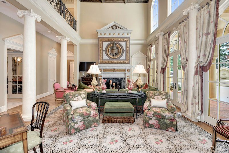Traditional Living Room With French Doors Stone Fireplace High Ceiling Arched Window