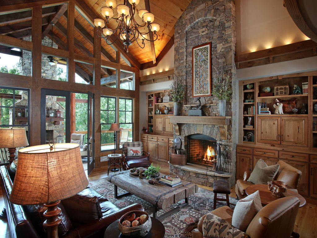 Rustic Great Room with Leather armchair  Hardwood floors  Built in  bookshelf  HighRustic Great Room with Built in bookshelf by Joe Folsom   Zillow  . Great Room With Fireplace. Home Design Ideas