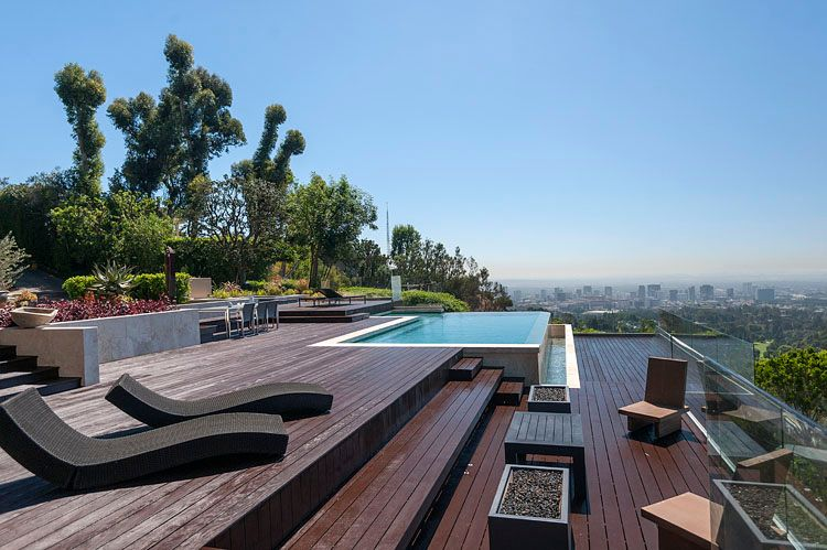 Modern Swimming Pool With Infinity Pool By Jackie Turner Zillow Digs Zillow