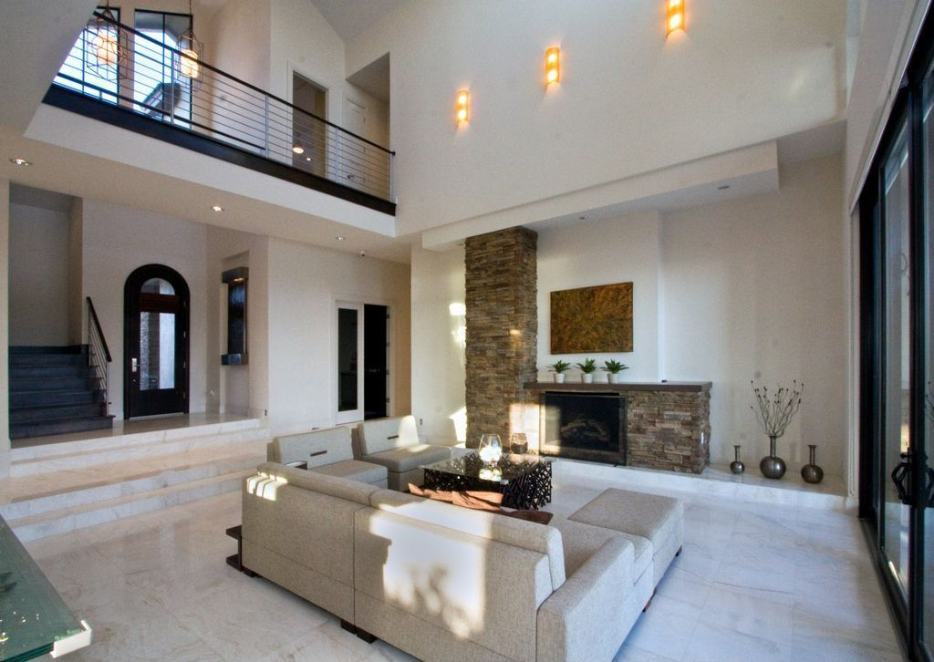 Living Room with stone fireplace & travertine tile floors in ...