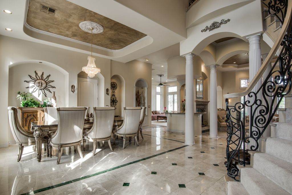 Dark Travertine Tile traditional dining room with specialty door & travertine tile