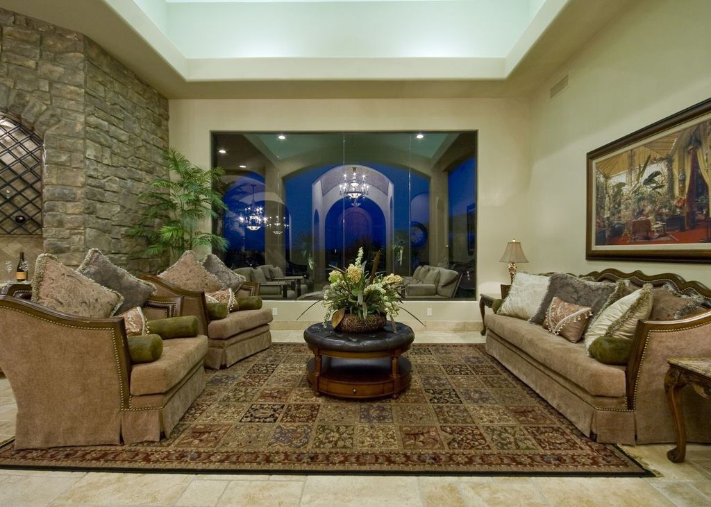 Mediterranean Living Room With High Ceiling Interior Stacked Stone Wall Persian Rug Carpet
