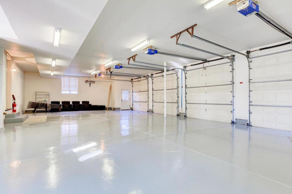 18x20 Garage With High Cielings : Contemporary garage with flush light carpet in new