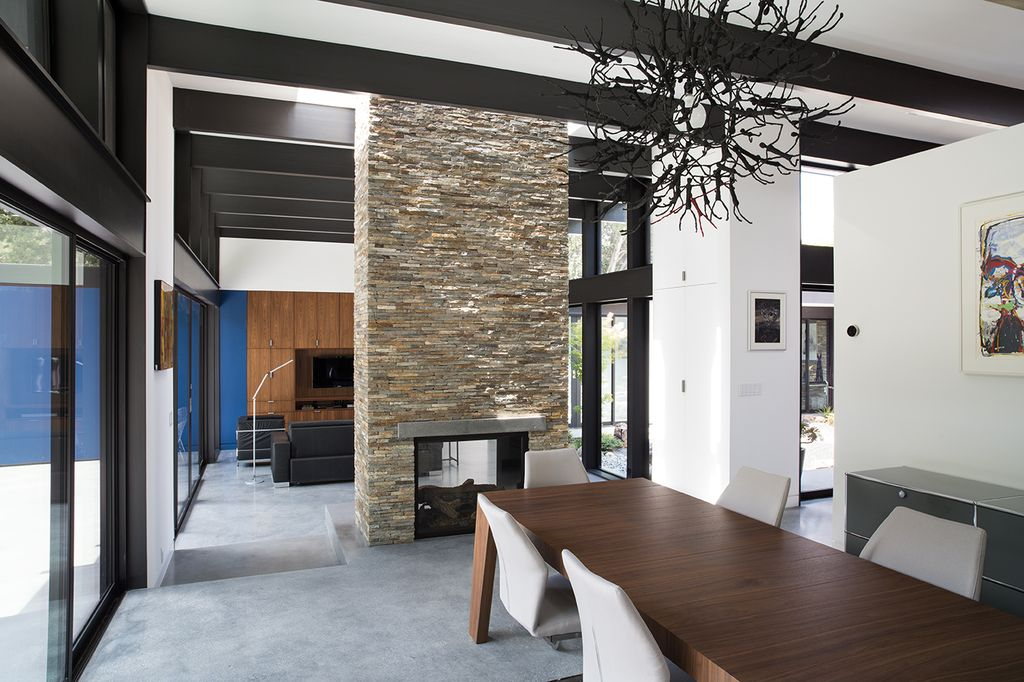 contemporary dining room with concrete floorsklopf