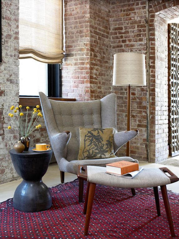 Eclectic Living Room with Concrete floors & interior brick ...
