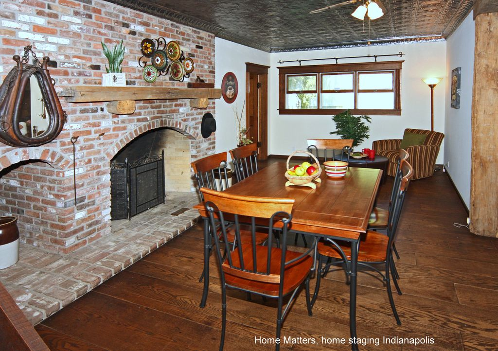 Rustic Dining Room With Ceiling Fan, Wide Plank Oak Flooring, Metal  Fireplace, Natural