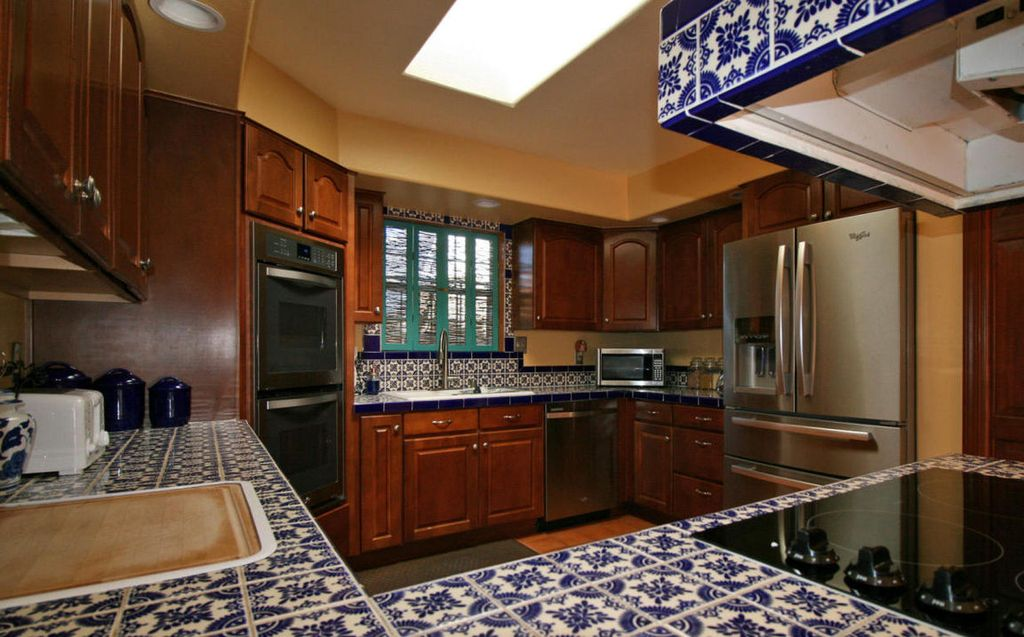 kitchen with mexican tile backsplash & u-shaped in albuquerque, nm