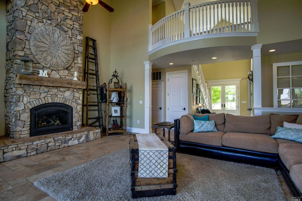 Traditional Living Room with Ceiling fan & metal fireplace in ...