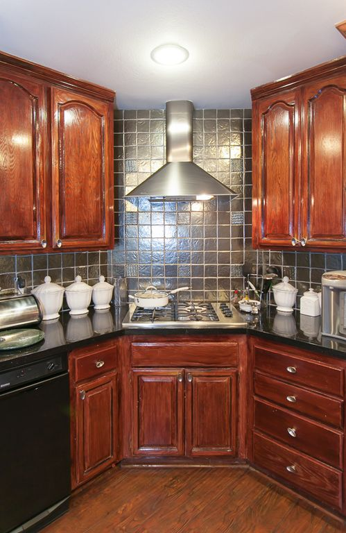 traditional kitchen with raised panel & slate tile in sherman oaks