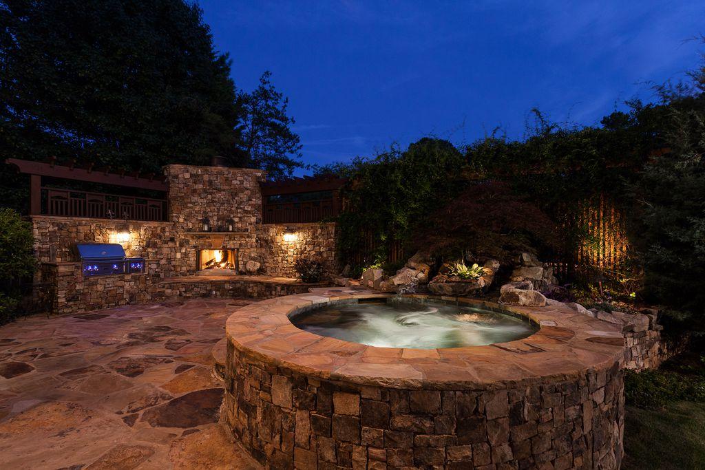 Mediterranean Hot Tub With Outdoor Pizza Oven Trellis Outdoor Kitchen Exterior Stone Floors