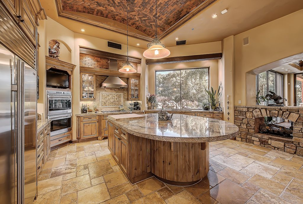 Traditional kitchen with kitchen island limestone tile for Traditional rustic kitchen