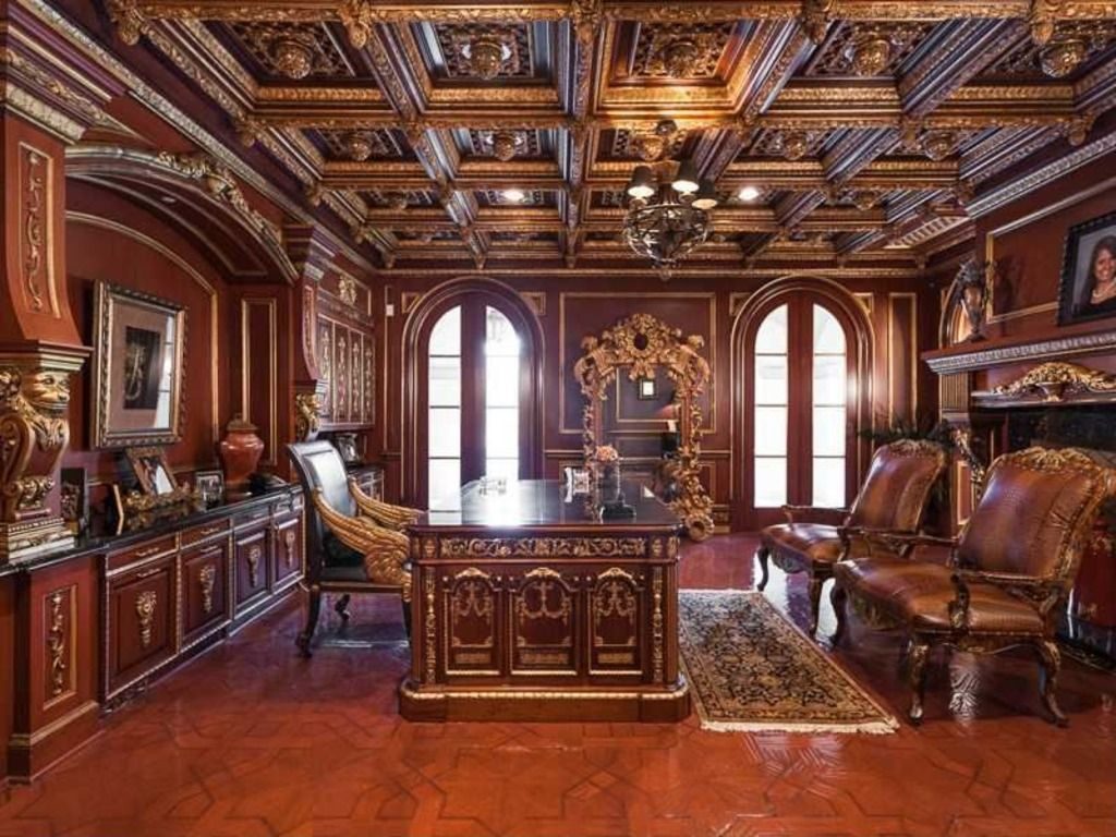 traditional home office with arched window chandelier crown molding box ceiling built
