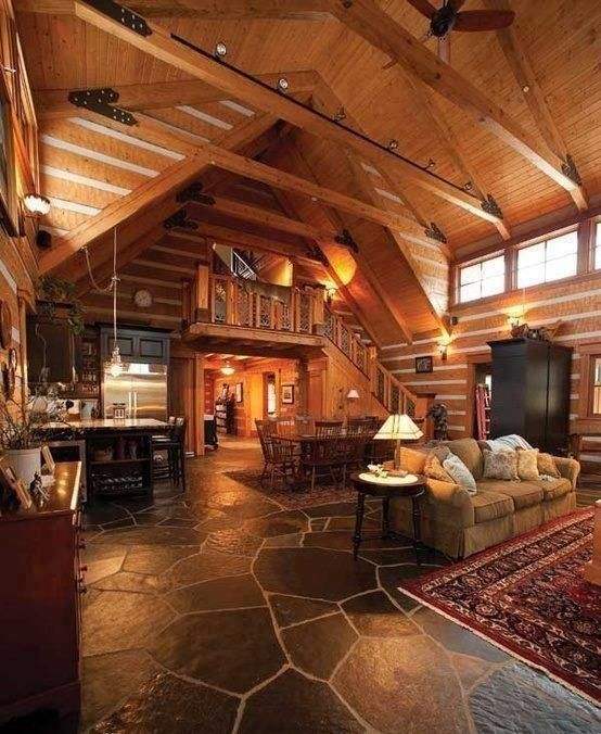 Rustic great room with exposed beam built in bookshelf for Rustic great room