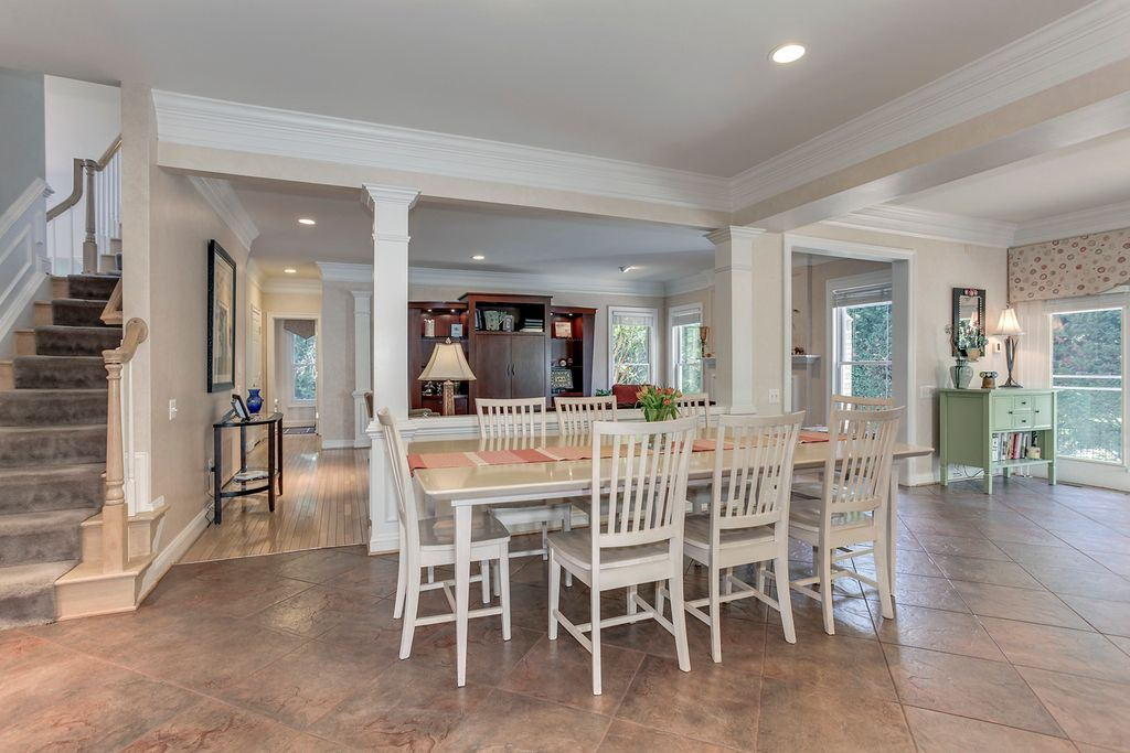 Traditional Dining Room With Exposed Beam, Columns, Sandstone Tile Floors,  Crown Molding