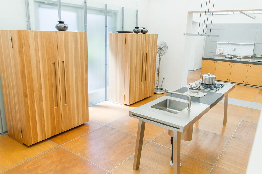 Contemporary kitchen with l shaped by dawson clinton for Bulthaup kitchen cabinets