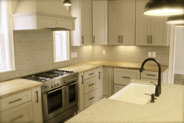 Traditional Kitchen With Heirloom Wood Countertops Natural Bamboo Plank,  Fossil Solid Surface Countertop, Corian