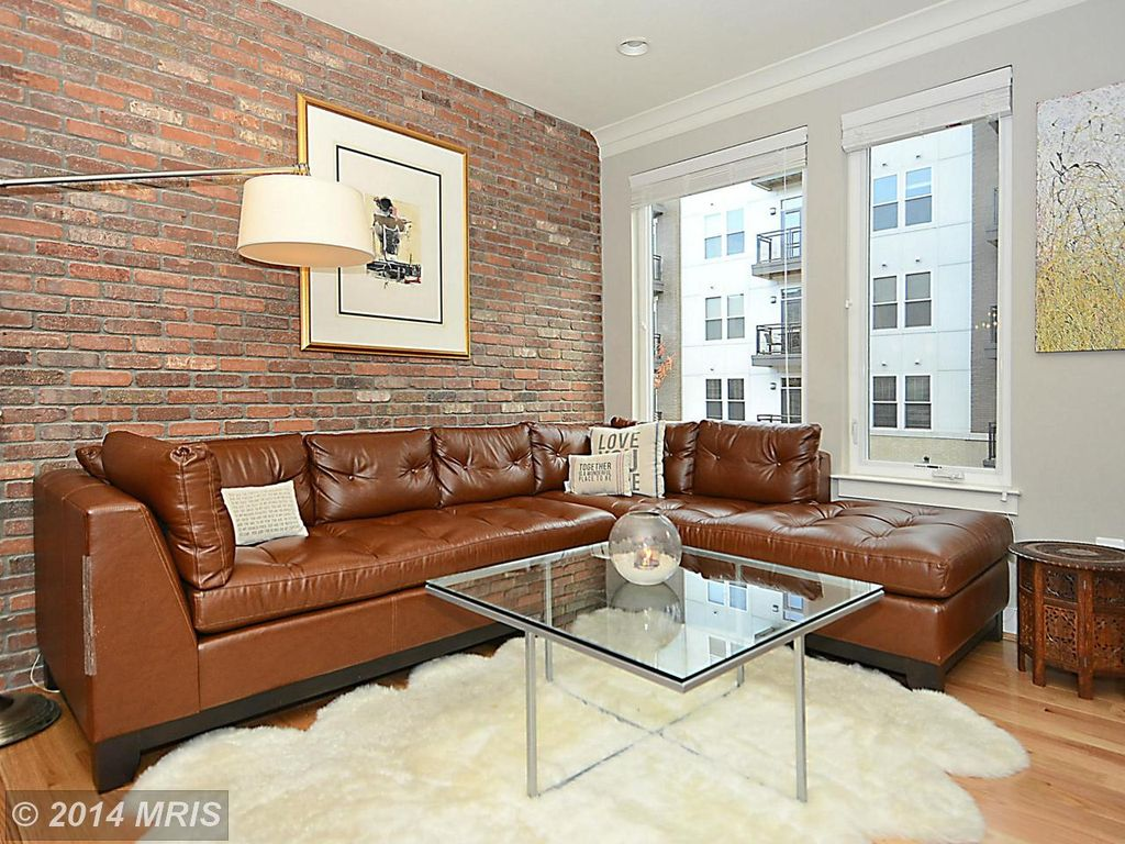 Crown molding designs living rooms - Contemporary Living Room With Hardwood Floors Crown Molding Interior Brick
