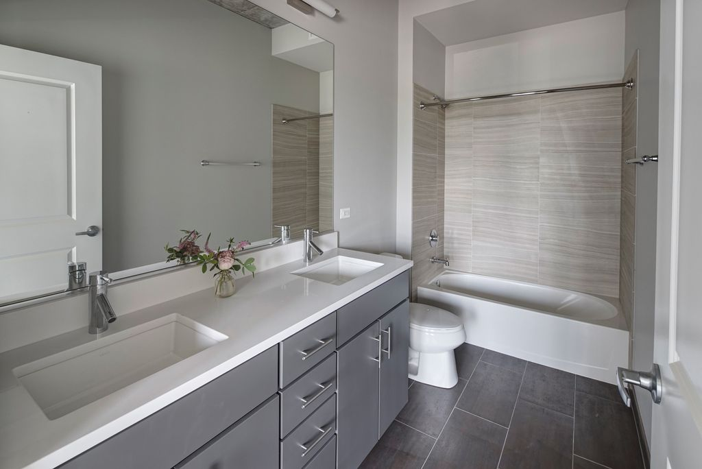 Modern master bathroom with corian counters drop in for Bathroom designs gray