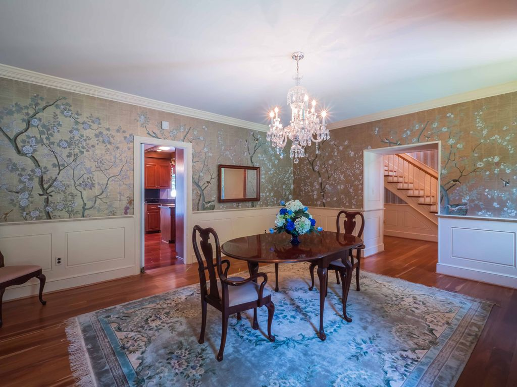 Traditional Dining Room With Carpet High Ceiling Wainscoting Chandelier Crown Molding
