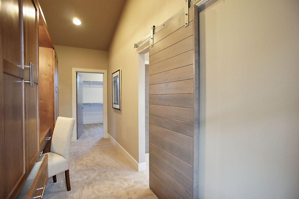 Transitional Hallway With Built In Bookshelf, Carpet, Barn Door, Sliding  Door