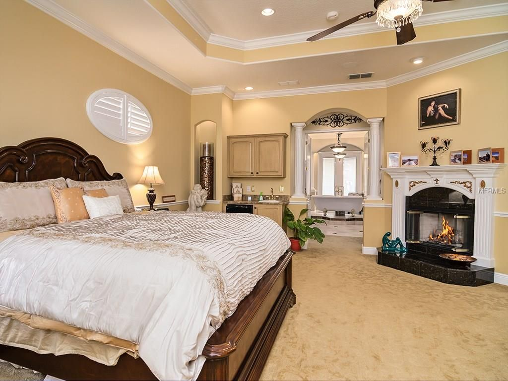 Bedroom stone fireplace - Traditional Master Bedroom With Chair Rail Stone Fireplace Ceiling Fan High Ceiling